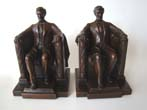 click to view detailed description of An exceptionally fine pair of Abraham Lincoln 'in the chair' bookends by Jennings Brothers of Meriden, CT, circa 1925